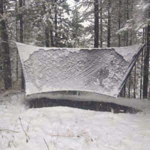 summit 4 season hammock tarp covered with snow.