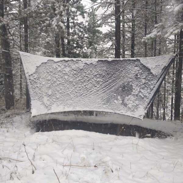 summit 4 season hammock tarp covered with snow.