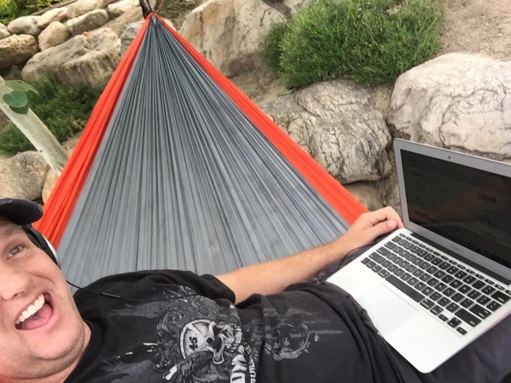 man working inside his hammock